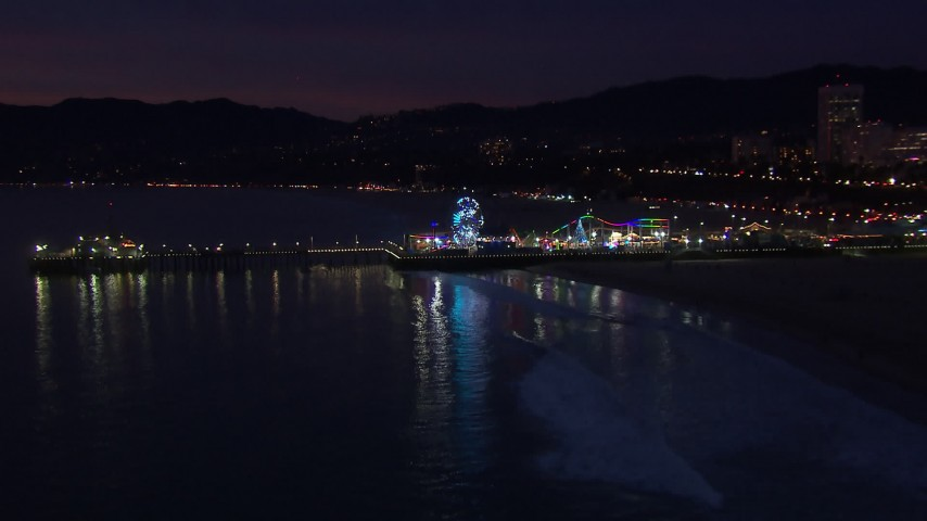 HD stock footage aerial video approach Ferris wheel and rides at night, Santa Monica Pier, California Aerial Stock Footage | CAP_018_112