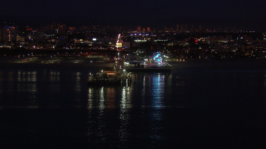 HD stock footage aerial video approach the Ferris wheel and rides at night, Santa Monica Pier, California Aerial Stock Footage | CAP_018_114