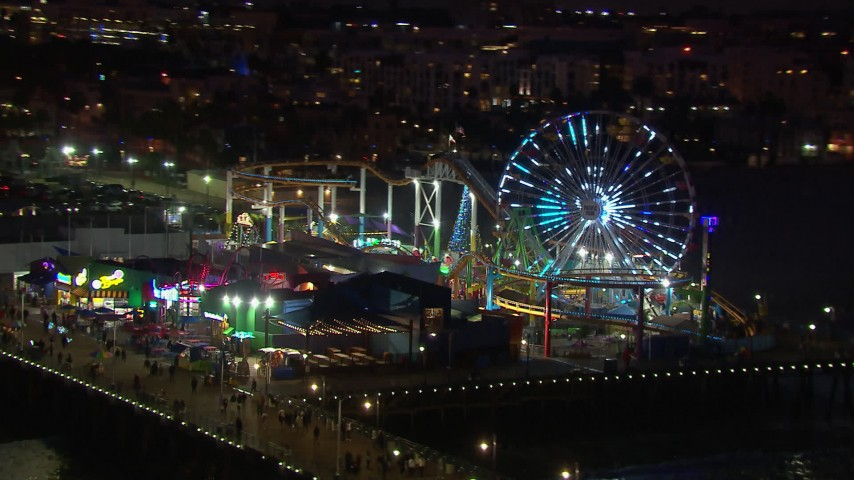 HD stock footage aerial video orbit the Ferris wheel and rides at night, Santa Monica Pier, California Aerial Stock Footage | CAP_018_116