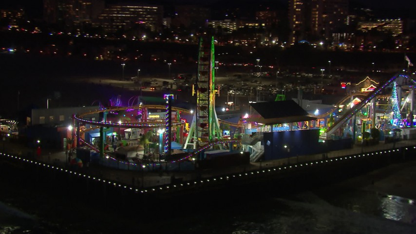 HD stock footage aerial video circling the Ferris wheel and rides at nighttime, Santa Monica Pier, California Aerial Stock Footage | CAP_018_120