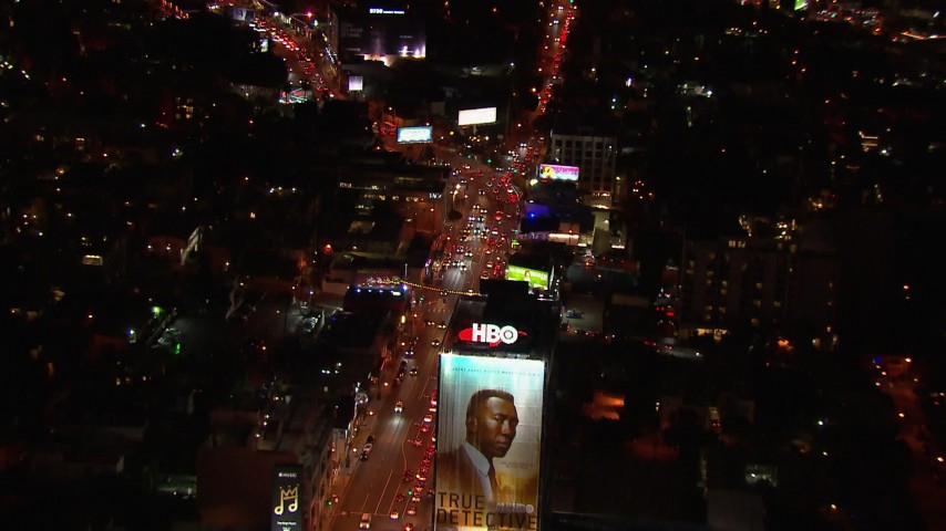 HD stock footage aerial video fly over billboard for view of traffic on the Sunset Strip at night in West Hollywood, California Aerial Stock Footage | CAP_018_127