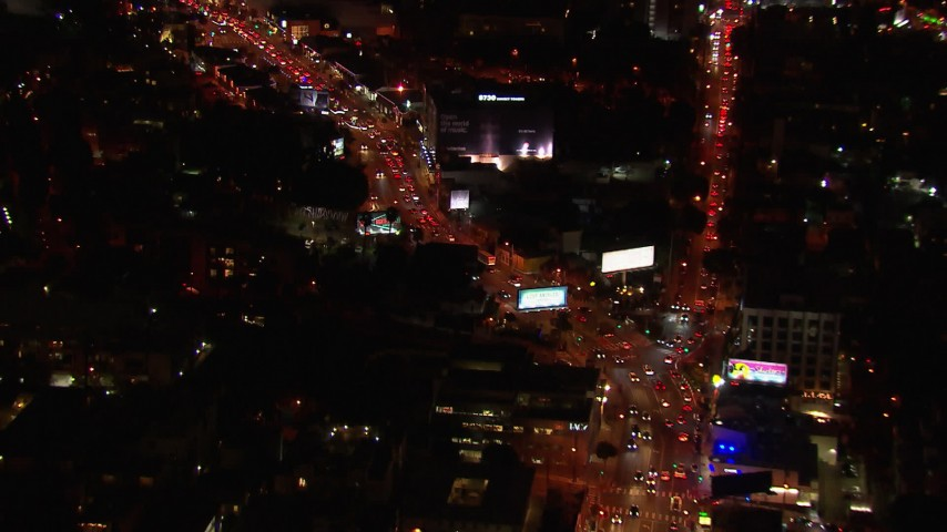 HD stock footage aerial video of following traffic on the Sunset Strip at night in West Hollywood, California Aerial Stock Footage | CAP_018_128