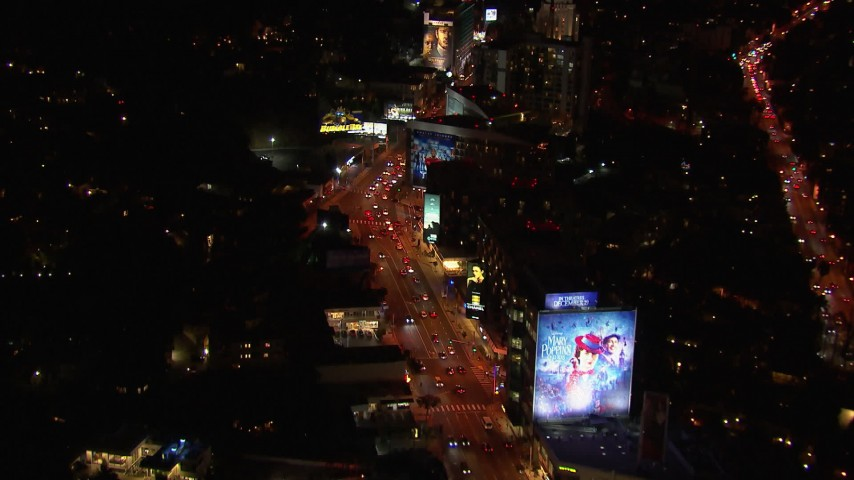 HD stock footage aerial video of flying over the Sunset Strip at night in West Hollywood, California Aerial Stock Footage | CAP_018_130