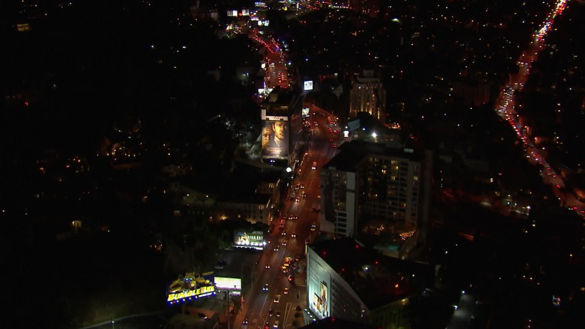 HD stock footage aerial video of light traffic on the the Sunset Strip at night in West Hollywood, California Aerial Stock Footage | CAP_018_131