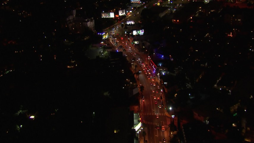 HD stock footage aerial video of zooming to light traffic on the Sunset Strip at night in West Hollywood, California Aerial Stock Footage | CAP_018_132