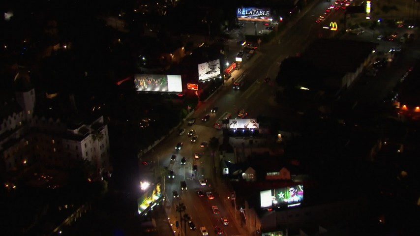 HD stock footage aerial video of light traffic traveling the Sunset Strip at night in West Hollywood, California Aerial Stock Footage | CAP_018_133