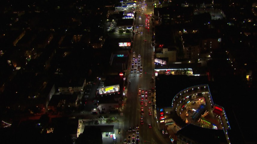 HD stock footage aerial video of following Sunset Blvd at night through Hollywood, California Aerial Stock Footage   CAP_018_134