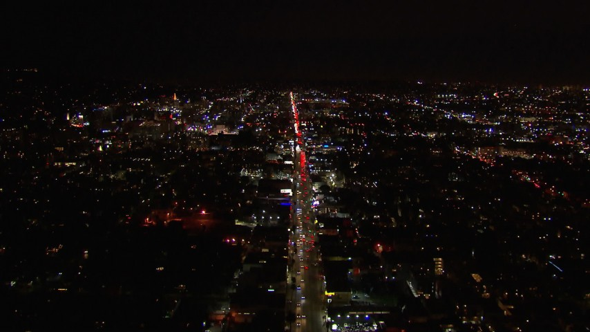 HD stock footage aerial video of following Sunset Blvd through Hollywood at night, California Aerial Stock Footage | CAP_018_136