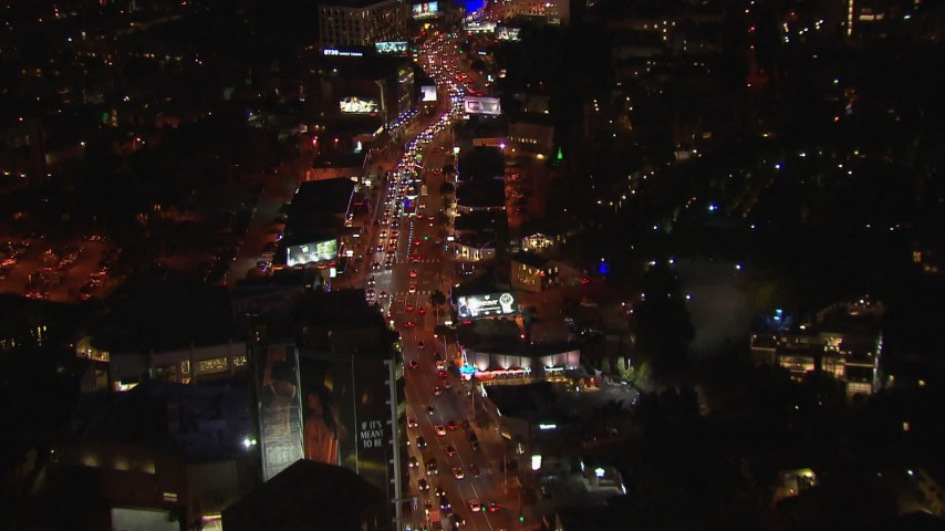 HD stock footage aerial video fly above Sunset Strip billboards and traffic at night in West Hollywood, California Aerial Stock Footage | CAP_018_141