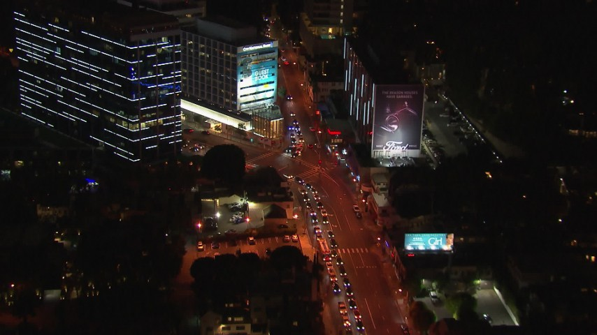 HD stock footage aerial video of cars lining Sunset Strip at night in West Hollywood, California Aerial Stock Footage | CAP_018_145