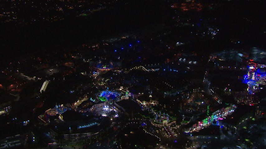 HD stock footage aerial video of orbiting the Universal Studios Hollywood theme park at night, Universal City, California Aerial Stock Footage | CAP_018_166