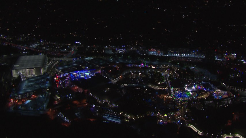 HD stock footage aerial video of flying around the Universal Studios Hollywood theme park at night, Universal City, California Aerial Stock Footage | CAP_018_169