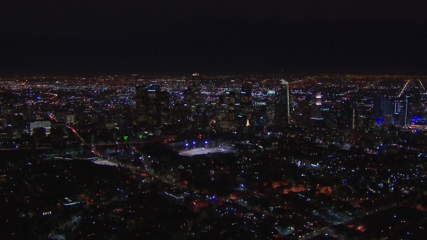 HD stock footage aerial video of flying by the city's skyline at night in Downtown Los Angeles, California Aerial Stock Footage | CAP_018_170