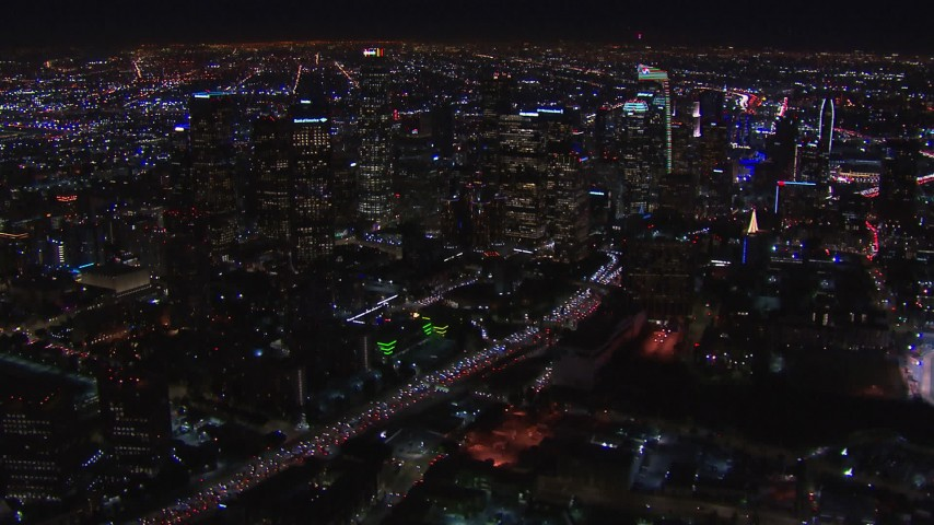 HD stock footage aerial video of passing by the city's skyline at night in Downtown Los Angeles, California Aerial Stock Footage | CAP_018_172