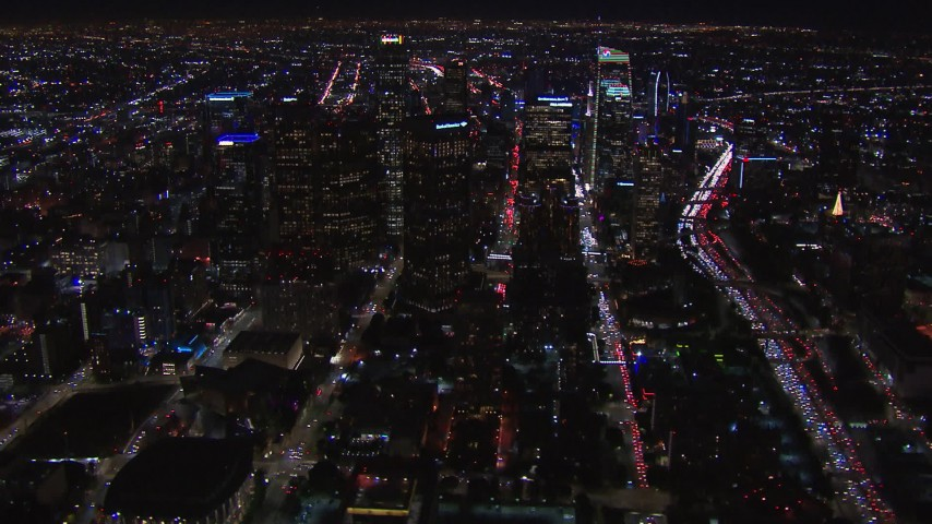 HD stock footage aerial video of flying past the city's skyline at night in Downtown Los Angeles, California Aerial Stock Footage | CAP_018_173