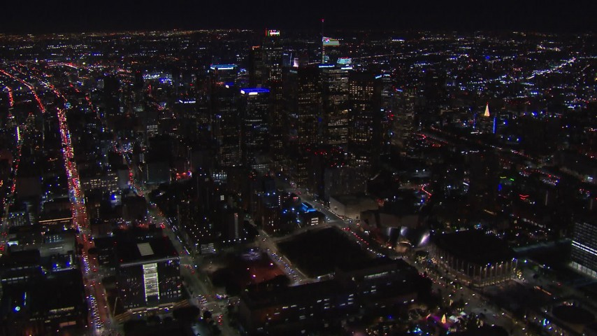 HD stock footage aerial video of flying away from the city's skyline at night in Downtown Los Angeles, California Aerial Stock Footage | CAP_018_174