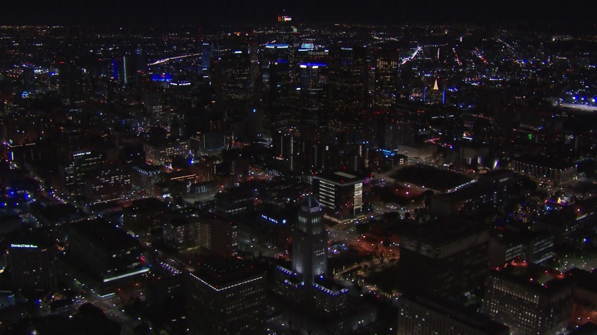 HD stock footage aerial video of flying away from and past city hall and the city's skyline at night in Downtown Los Angeles, California Aerial Stock Footage | CAP_018_175