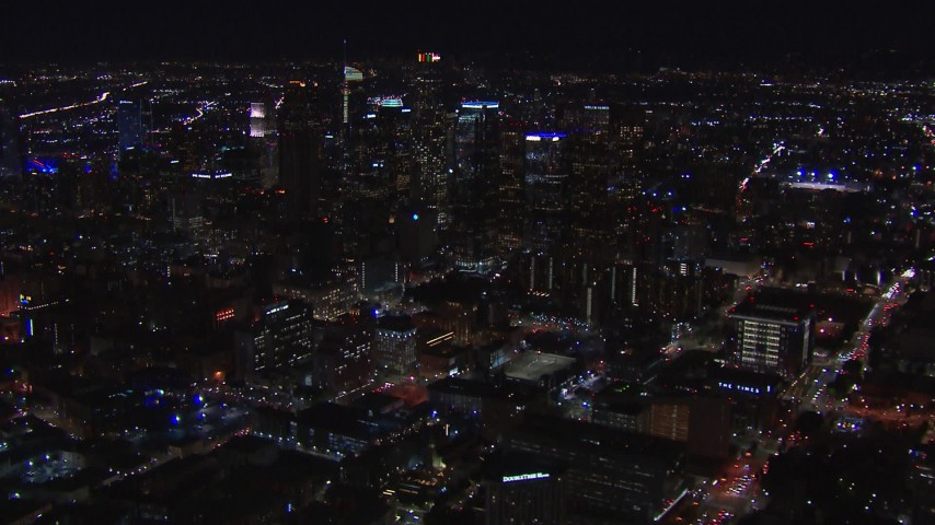 HD stock footage aerial video of flying past the city's skyline at night in Downtown Los Angeles, California Aerial Stock Footage | CAP_018_176