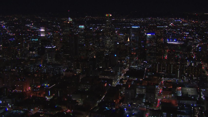 HD stock footage aerial video of flying by the city's skyline at night in Downtown Los Angeles, California Aerial Stock Footage | CAP_018_177