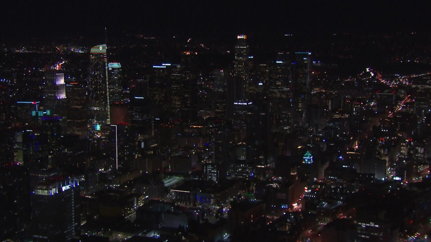 HD stock footage aerial video of an orbit of the city's skyline at night in Downtown Los Angeles, California Aerial Stock Footage | CAP_018_182