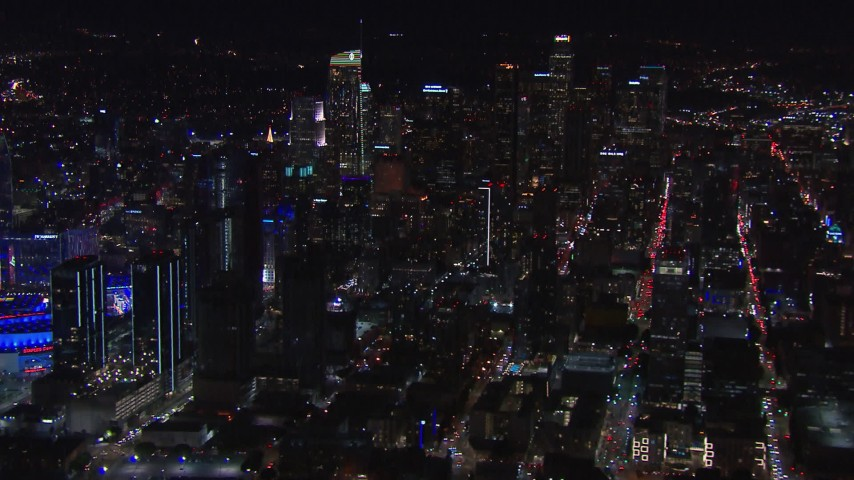 HD stock footage aerial video flyby the city's skyline at night to reveal Staples Center, Downtown Los Angeles, California Aerial Stock Footage | CAP_018_183