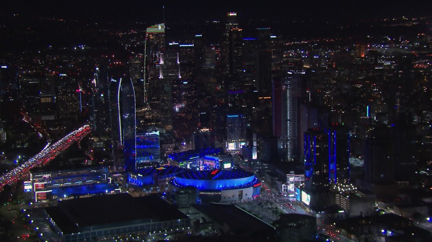 HD stock footage aerial video passing by Staples Center and the city's skyline at night, Downtown Los Angeles, California Aerial Stock Footage | CAP_018_185