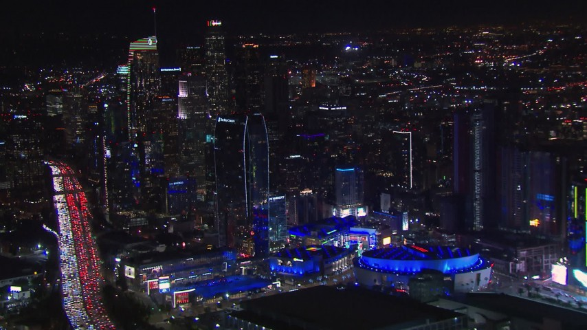HD stock footage aerial video of Staples Center and the city's skyline at night, Downtown Los Angeles, California Aerial Stock Footage | CAP_018_186