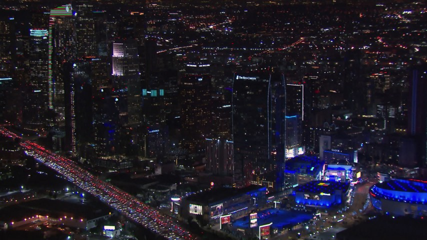 HD stock footage aerial video pan from city's skyline to Staples Center at night, Downtown Los Angeles, California Aerial Stock Footage | CAP_018_187