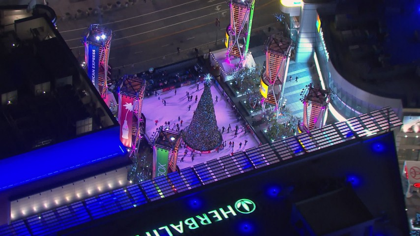 HD stock footage aerial video of orbiting an ice skating rink at night, Downtown Los Angeles, California Aerial Stock Footage | CAP_018_191