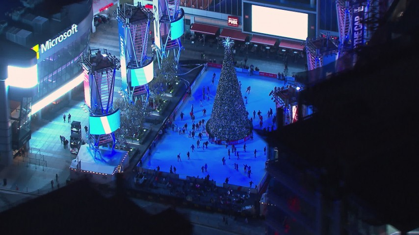 HD stock footage aerial video of an ice skating rink and Christmas tree at night, Downtown Los Angeles, California Aerial Stock Footage | CAP_018_192