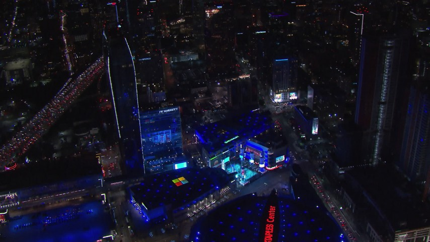 HD stock footage aerial video orbit ice skating rink and Christmas tree by theater at night, Downtown Los Angeles, California Aerial Stock Footage | CAP_018_194