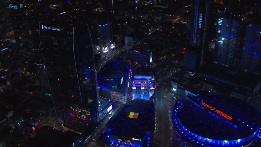 HD stock footage aerial video orbit ice skating rink by theater and Ritz-Carlton at night, Downtown Los Angeles, California Aerial Stock Footage | CAP_018_195
