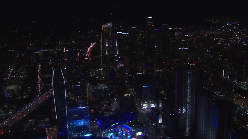 HD stock footage aerial video of the Downtown Los Angeles skyline at night, California Aerial Stock Footage | CAP_018_199