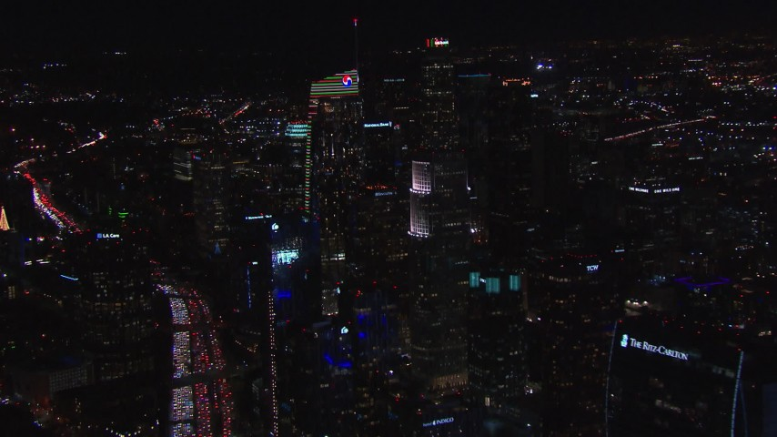 HD stock footage aerial video of approaching Wilshire Grand Center at night, Downtown Los Angeles, California Aerial Stock Footage | CAP_018_200
