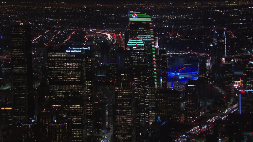 HD stock footage aerial video zoom to wider view of towering skyscrapers at night, Downtown Los Angeles, California Aerial Stock Footage   CAP_018_206