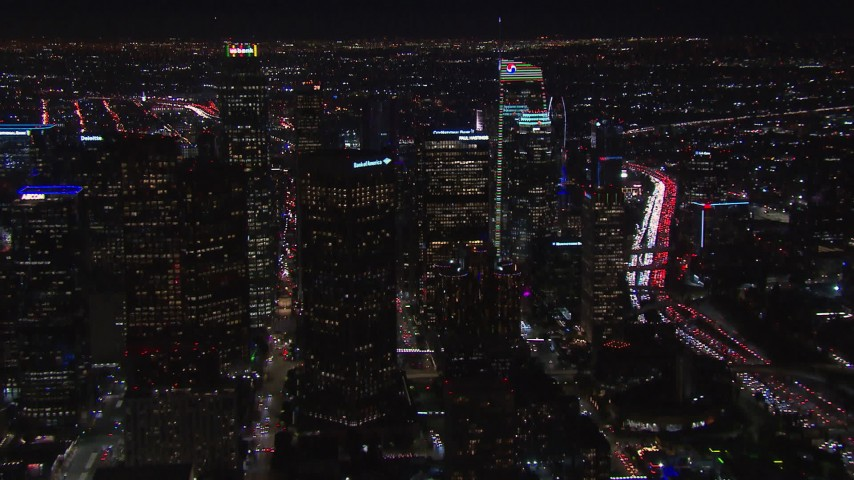 HD stock footage aerial video of flying way from tall skyscrapers at night, Downtown Los Angeles, California Aerial Stock Footage | CAP_018_207