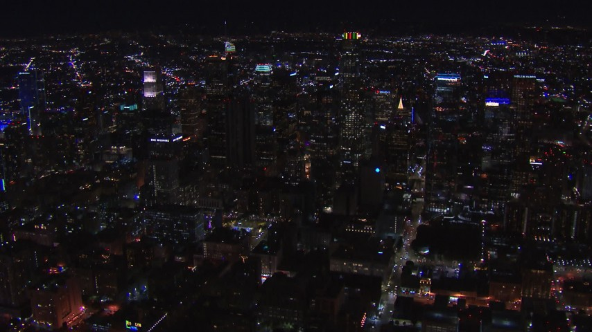 HD stock footage aerial video of passing tall skyscrapers at night, zoom closer to US Bank Tower, Downtown Los Angeles, California Aerial Stock Footage | CAP_018_210
