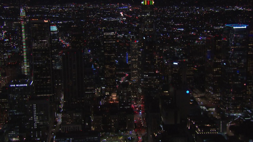 HD stock footage aerial video of orbiting tall skyscrapers at night, zoom closer to nearby high-rises, Downtown Los Angeles, California Aerial Stock Footage | CAP_018_211