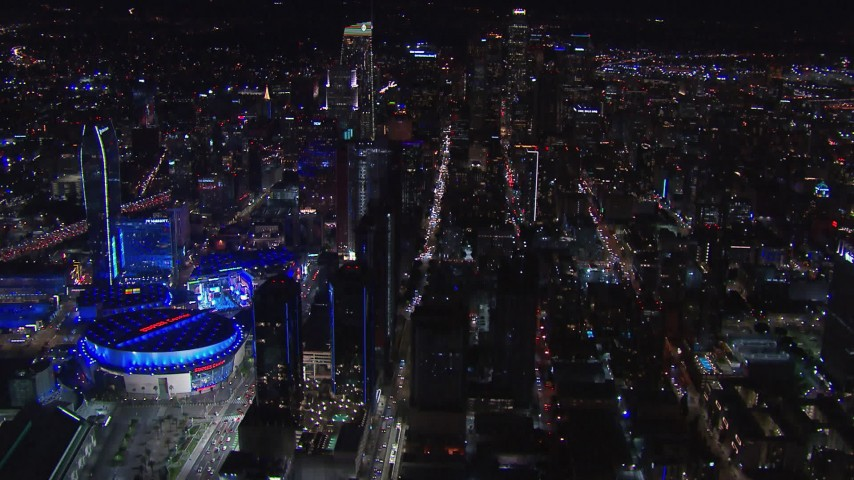 HD stock footage aerial video wide view of skyline at night, reveal Staples Center, Downtown Los Angeles, California Aerial Stock Footage | CAP_018_215