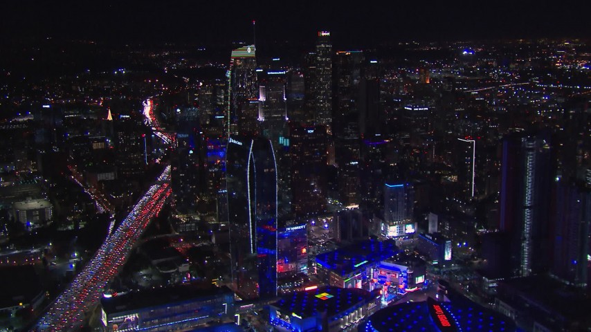 HD stock footage aerial video wide view of skyline at night, seen from Staples Center, Downtown Los Angeles, California Aerial Stock Footage | CAP_018_216