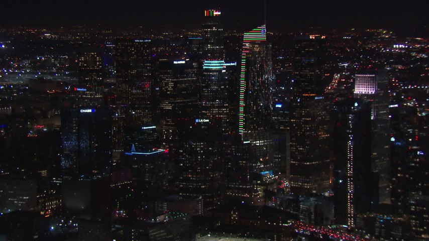 HD stock footage aerial video flying by Wilshire Grand Center and skyline at night, Downtown Los Angeles, California Aerial Stock Footage | CAP_018_218