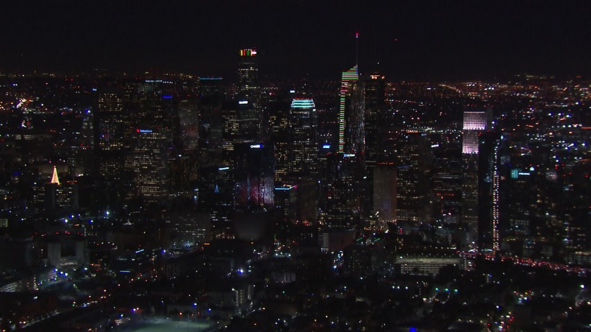 HD stock footage aerial video zooming to wider view of skyline at night, Downtown Los Angeles, California Aerial Stock Footage | CAP_018_219