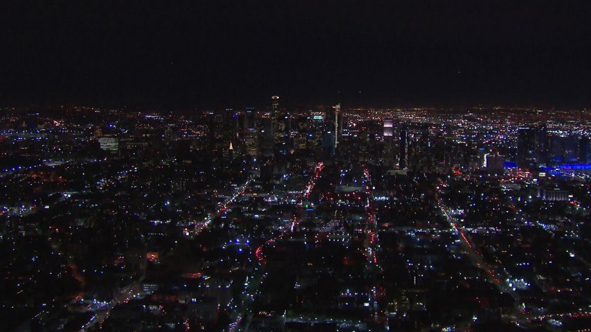 HD stock footage aerial video wide view of city's skyline in the distance at night, Downtown Los Angeles, California Aerial Stock Footage | CAP_018_221