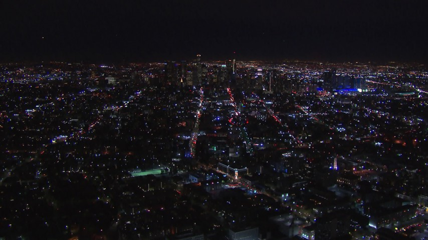 HD stock footage aerial video of the distant downtown skyline at night, Downtown Los Angeles, California Aerial Stock Footage | CAP_018_222