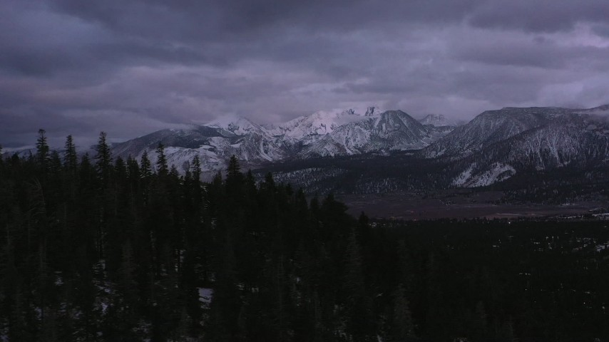 4K stock footage aerial video of a wide view of snowy mountain peak in the distance, Inyo National Forest, California Aerial Stock Footage | CAP_019_023