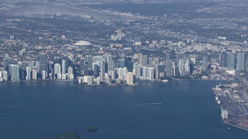 HD stock footage aerial video of flying by the city's downtown skyline, Downtown Miami, Florida Aerial Stock Footage | CAP_020_007