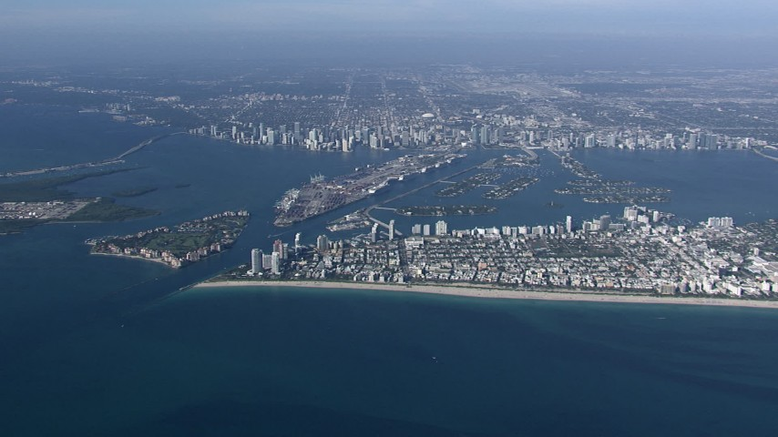 HD stock footage aerial video of approaching South Beach with a wide view of the bay, port and islands near Downtown Miami, Florida Aerial Stock Footage | CAP_020_009