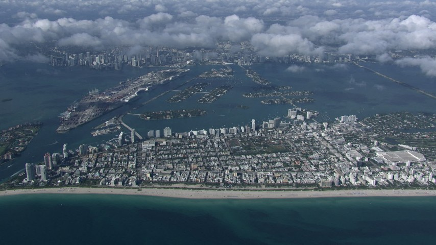 HD stock footage aerial video of slowly passing South Beach, seen from high altitude, Miami, Florida Aerial Stock Footage | CAP_020_011
