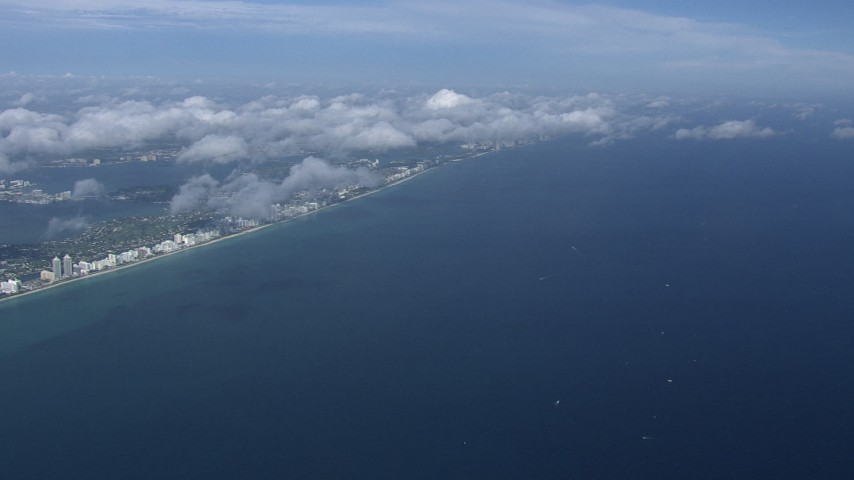 HD stock footage aerial video of a high altitude view of Miami Beach and the Atlantic Ocean, Florida Aerial Stock Footage | CAP_020_013