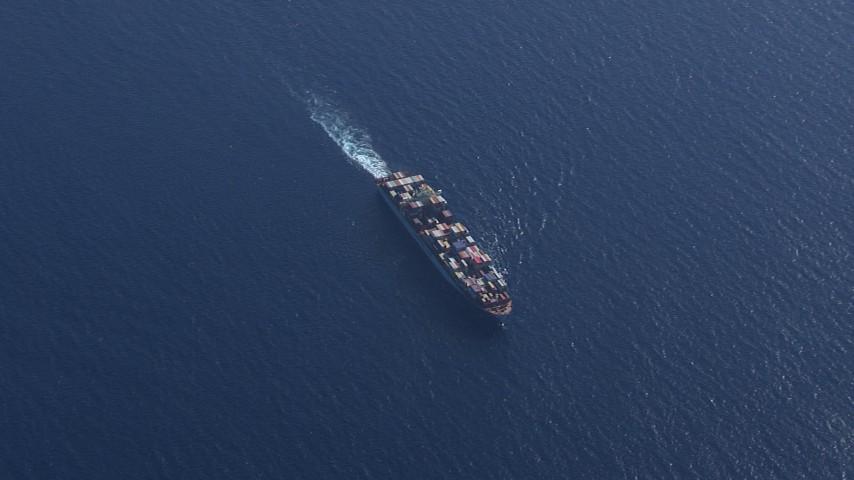 HD stock footage aerial video of a bird's eye view of a cargo ship near Miami Beach, Florida Aerial Stock Footage | CAP_020_015
